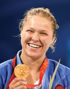 Ronda Rousey: The World's Most Dangerous Woman  How did Ronda Rousey go from living in her car to being MMA's most unstoppable force?    http://www.rollingstone.com/sports/features/ronda-rousey-the-worlds-most-dangerous-woman