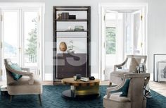 A Hoplon Bookcase against the wall in an interior furnished with Lallan Center Table II, ENZ Rug and Eanda Armchairs. #brightlivingroom #luxurylivingromm