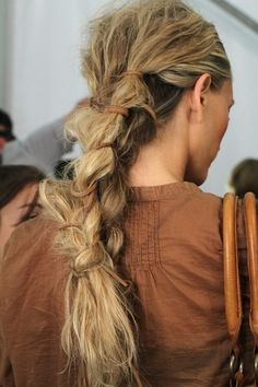 Messy and elegant braid. A well traveled woman