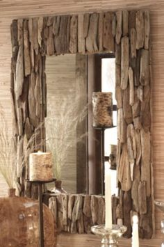 Driftwood mirror. Would be fun to make out of pieces that you have collected on various trips to the beach. With a date on each one maybe? Assuming one is still allowed to take driftwood home from the beach.....