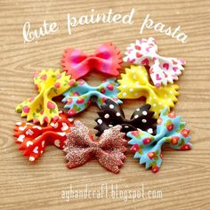 DIY Hand Painted Pasta. While I love my painted elbow macaroni necklaces, these are really pretty. This comes from the blog of 17 year old Argentinian Augustina who used the bow tie pasta on cards. Found on Made with Love here.