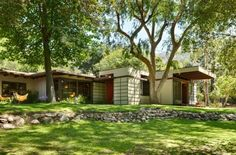 Tim Andersen, Architect.  Mid-century remodel. Addition we designed was placed south of 1949 house with new entry in between.  Existing sycamore maple tree defined limits of expansion and location of living room.