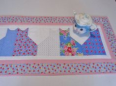 Image result for cloth cats for table toppers