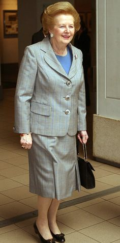 Margaret Thatcher arrives at the imperial was museum in a grey skirt suit