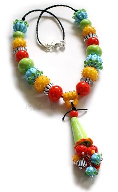 Chikeeta is a super fun and funky glass necklace made of colorful, mostly hollow, handmade lampwork beads.   -   Hippkittybeads