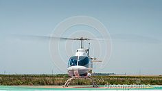 White helicopter take off in plain grass field, front view. Copy space at top on clear blue sky. Grass Field, Clear Blue Sky, Wind Turbine, Aviation, Stock Photos, Space, Top, Wedding, Floor Space