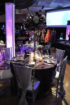 Allure Events table top design in elegant shades of plum and silver http://weddingshows.com