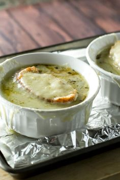 Warm and cozy French Onion Soup. Use your slow cooker to caramelize the onions overnight to save time!  girlgonegourmet.com