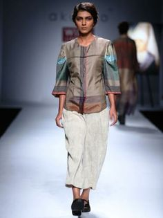 http://www.runwayfashion.in : A model walks the ramp for Gaurav Gupta