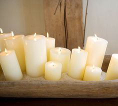 candles grouped in a wooden bowl - all the same color but different sizes -I can feel myself starting to relax .....