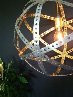 Great DIY industrial chic pendant light Want to repurpose rusty old wine barrel bands to make