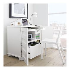 Incognito White Compact Office. Space for printer, file drawer, keyboard and it all closes up to look like a small cupboard. At Crate & Barrel.