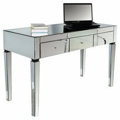 """3-drawer desk with wood framing and beveled mirror paneling.  Product: DeskConstruction Material: Mirrored glass and woodColor: SilverDimensions: 30"""" H x 49"""" W x 21.5"""" D"""