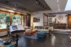 Contemporary dark Living room with strong ethnic influences overlooking the garden. Split level modern living and dining room with indoor courtyard garden. Ethnic Living Room, Dark Living Rooms, Indian Living Rooms, Living Room Interior, Modern Living, Living Room Ideas India, Small Living, Living Area, Indian Home Design
