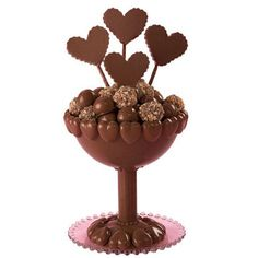True Love Truffles - It's a chocolate lover's dream come true. Serve exquisite chocolate truffles in a chocolate goblet. Shape goblet using Sports Ball Pan Set covered with melted chocolate. Make candy heart pops and candies to embellish the lavishly rich confection.