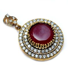 Silvesto India Ruby And Topaz (Lab) 925 Sterling Silver With Bronze Pendant PG-7194  https://www.amazon.co.uk/dp/B01H5J3DBG