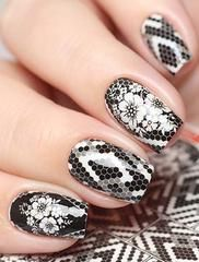 Here are some water decals that have a black and white hexagon tile design along flowers to top your nails with.