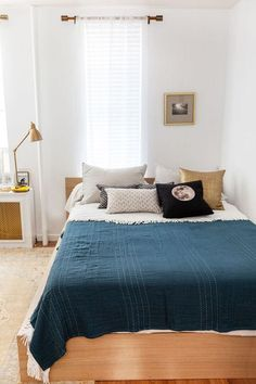 NYC Small-Space Apartment Makeover Industrial Task Table Lamp + Gauze Stitched Blanket from west elm Small Space Design, Small Space Living, Bed Against Window, Window Bed, Home Bedroom, Bedroom Decor, Airy Bedroom, Budget Bedroom, Bedroom Inspo