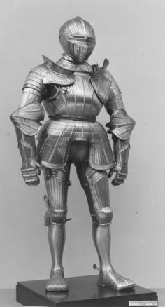 This is a fine late example of a fluted armor, made shortly before the style went out of fashion. It is distinguished for its unusually large proportions and impressive height. The bands of scales and the distinctive roping of the lower edge of the associated helmet and the top edge of the breastplate are features frequently found on armors from northern Germany (possibly Brunswick), a region generally not known for producing fluted armors