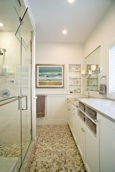 Here's another thought if you're in the planning stages of a bathroom: storage amongst the cabinets. By simply raising the countertop and slipping in four narrow slats, this homeowner instantly has useful storage space for towels.