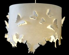 Drawn to the Light This pendant lampshade is as whimsical as it gets, with cutouts that set butterflies aflutter, casting fanciful shadows across the room. In a soft white wool, however, the lamp is anything but cutesy:  Just this view...