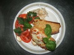 Bruschetta from natural baked Bread filed Tometoes without seeds , wits some basil and garlic cowered Mozzarella chesse .