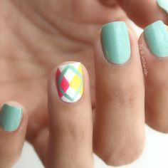 This manicure features a gorgeous mint shade polish and a detailed geometric pattern design on the ring finger. Get the amazing nail polish used to recreate this nail art. Mint Nail Art, Mint Nails, Nail Art Diy, Striped Nail Designs, Striped Nails, Nail Art Designs, Geometric Pattern Design, Ring Finger, Short Nails