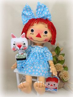 Raggedy ann doll with green dress with white flowers