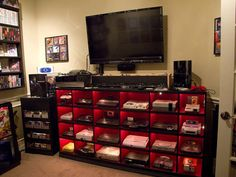 Not only do I wish I had this to hold consoles; I wish I had all of the consoles! My New Room, My Room, Spare Room, Video Game Heaven, Best Gaming Setup, Gamer Setup, Ultimate Gaming Setup, Gaming Room Setup, Ultimate Games