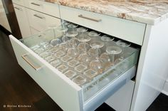 Store glassware upside down on nonslip rubber drawer liners | Kitchen by Divine Design+Build
