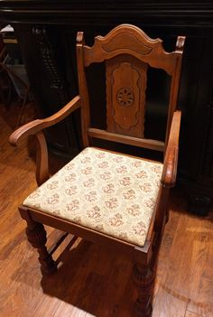 Antique solid walnut armchair with cream floral upholstery $65
