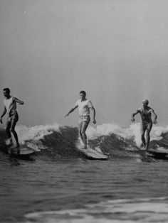 Men Riding the Waves on Surf Boards Premium Photographic Print at Art.com