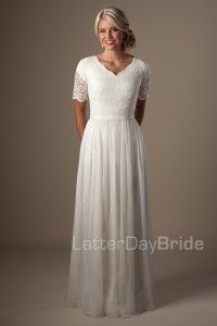 modest-wedding-dress-leonora-front.jpg I think this sleeve and waistline would be good on you. You could see if a full slip could make this into a 1/2 ballgown style.