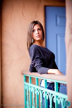 senior picture. I like the way she's leaned backwards against the rail & looking over her shoulder.