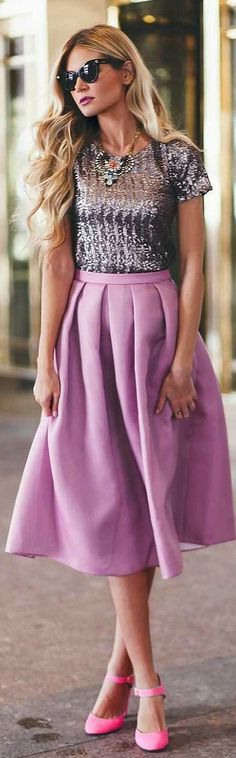 Sequin top, purple skirt, pink shoes.