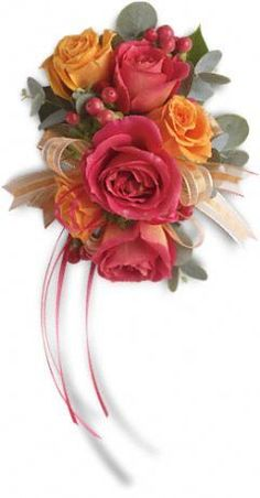 Warm orange and pink roses evoke the splendor of sunset. Hot pink and orange spray roses mingle with red hypericum and accents of Israeli ruscus and eucalyptus. Approximately 5 W x 7 1/2 H.