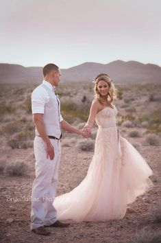 Love the groom's suit and her beautiful blush dress!!