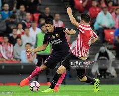 Barcelona's Uruguayan forward Luis Suarez vies with Athletic Bilbao's French…