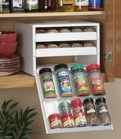 Photo Credit Unknown  Ideas like this one are essential for tiny house living. This space saving spice rack is the perfect antidote for a micro kitchen wh