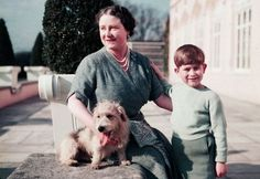 An informal photograph of Prince Charles as a small boy with the Queen Mother and a small dog called Pippin