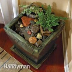 Create a tiny natural waterfall in your living room using a planter, rocks and a small pond pump.