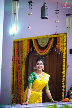 Pretty bride with elegant yellow musk silk saree enhanced beauty of the sandal body with rich contrast sandal tissue border merges well and brings the bride saree in to rich traditional touch.
