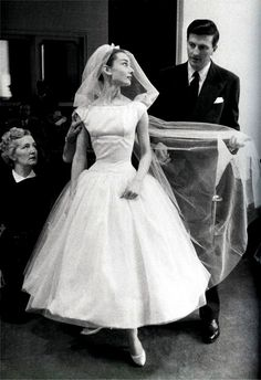 Givenchy S/S 1957, Audrey Hepburn on the set of 'Funny Face' being fitted in Hubert de Givenchy