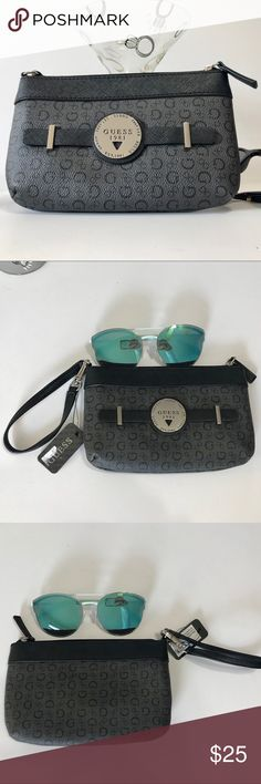 GUESS wristlet in COAL GUESS wristlet in COAL.  Zipper with inner pocket. Guess Bags Clutches & Wristlets