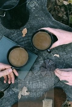 This is a Media Bakery licensable image titled 'Couple having coffee in a forest two mugs of coffee a coffee pot and a pair of gloves on a tree trunk.' by artist Mint Images for editorial and commercial use only. No use with out payment. Search our large selection of royalty free and rights managed stock photos.
