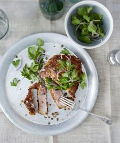 Parmesan veal schnitzel with parsley and caper topping.