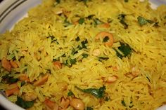 Curried Rice Pilaf. Serves 4. 1 small onion, 2 cloves garlic,zest of one small lemon,  1/2 tsp Curry Powder, pinch of Turmeric, 1 cinnamon stick,1 Tbsp unsalted butter, 1 tsp olive oil, 1 cup basmati rice, 1 1/3 cups water, 1/2 tsp sea salt, Juice from half a lemon, 1/8 cup chopped cilantro.