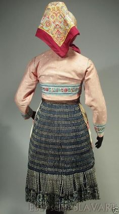 The blouse is made of fine cotton and has embroidery on the cuffs and neck ties. The skirt has a panel of white linen on the front, which should be visible on the sides, even when the apron is worn. Folk Costume, Costumes, Embroidered Apron, Pink Jacket, Folk Art, Lace Skirt, Blouse, Skirts, Cotton