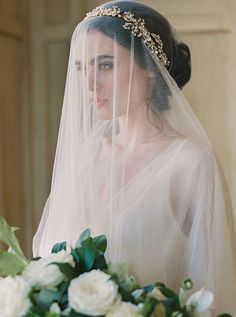 The blusher veil usually covers the entire face of a bride and falls around the shoulders. This veil is commonly paired with a long veil and used during the most conservative ceremonies. Read more!