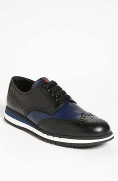 Prada. Casual laces top a retro-soled sneaker cut with traditional wingtip.